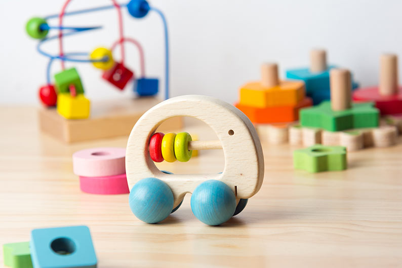 Toy car with blue wheels and other blocks